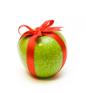 Fresh green apple packaging in red tape